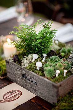 rustic moss, mushroom, and succulent wedding centerpiece