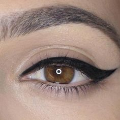 There's really nothing more classic than a winged eyeliner look, commonly referred to as the 'cat eye.' It's such a sleek, clean look, but it can be difficult to achieve without the proper technique. And really, what is the proper technique? The truth is...there isn't one. There are many! There are all sorts of techniques people use to create a winged eye. But I'm going to show you my way of getting the winged eye look below. - DivineCaroline.com
