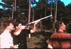Elvis vacation in july 1956 in Biloxi trying his new riffle.
