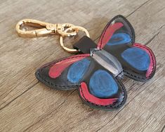 This butterfly design keychain, hand-painted on the real leather Leather Keyring, Leather Gifts, Real Leather, Keychain Design, Painting Leather, Instagram Shop, Leather Accessories, Designer Shoes, Gifts For Women