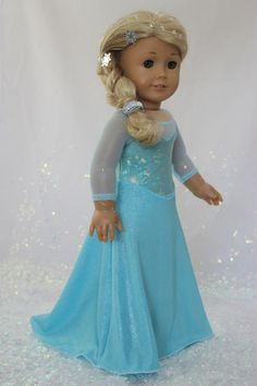 "MissyCrissy2 made this elegant Elsa from Frozen inspired gown for American Girl Dolls using Lee & Pearl's Pattern #1055: Skating Dresses for 18"" Dolls, our FREE April 2014 Newsletter tweak and the Lee & Pearl Ice Princess Fabric Kit. To make your own, get the pattern and fabric kit in our Etsy store at https://www.etsy.com/shop/leeandpearl and the FREE pattern tweak in our Newsletter Archive at http://leeandpearl.com/newsletters.html"