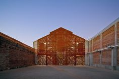 scanavini-barn: he south facade cladding is made in perforated Corten steel, with the design of the original facade in negative, linking the past, with the contemporary.