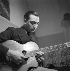 "Jean ""Django"" Reinhardt Using only the index and middle fingers of his left hand on his solos (his third and fourth fingers were paralyzed after an injury in a fire), Reinhardt invented an entirely new style of jazz guitar technique Jazz Artists, Jazz Musicians, Angus Young, Music Icon, My Music, Hifi Video, Gypsy Jazz Guitar, Django Reinhardt, Jazz Blues"