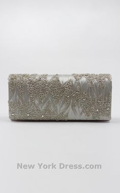 Nina Madera $45. Shop New York Dress at NewYorkDress.com or follow our blog at www.NewYorkDress.com/blog. #fashion #party #prom #nyc #gowns #accessories #promdresses #weddingdresses #eveninggowns #silver #clutch #glitter
