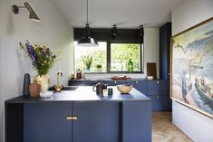 villa with brand new kitchen in bright blue. Details in brass and industrial interior with a touch of vintage ceramics and art. Kitchen Tiles, New Kitchen, Kitchen Island, Utensil Storage, Industrial Interiors, Vintage Ceramic, Open Shelving, Kitchen Interior, Wall Tiles