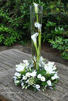 love use the tall vase with flowers circling