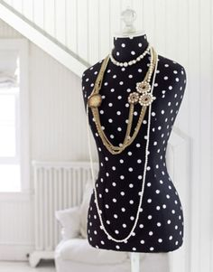 I love polka dots and dress forms.