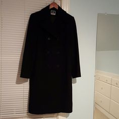 NWOT Wool-cashmere coat Knee-length black wool-cashmere coat. Double-breasted tailored front. Princess seams in back for flattering fit with back slit. Perfect condition, no flaws. Anne Klein Jackets & Coats Pea Coats