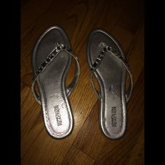 Kenneth Cole Reaction sandals These are by Kenneth Cole Reaction. They are silver with gems. Have some bent marks on them and a little tear in the spot between your toes. Worn twice. Kenneth Cole Reaction Shoes Sandals