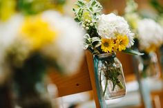 Aisle floral display idea. Maybe not mason jar (too narrow for reception tables).