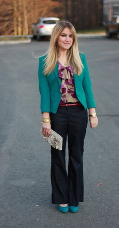 tan/beige/pink top with turquoise jacket and jeans