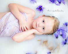 Child's milk bath- Sarah'Cole Photography.   Milk bath, lavender, purple, flowers,  little girl, blue eyes, soft, innocent, beautiful, angelic, daisies
