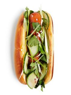 Pekingese Dogs : Sprinkle hot dogs with five-spice powder; grill, brushing with hoisin or plum sauce. Serve on toasted potato buns with sliced cucumbers, scallions, cilantro and more sauce.