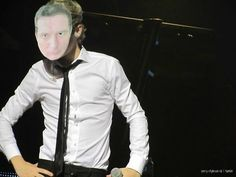 Niall wearing a Paul mask! This is brilliant