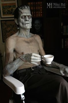 Life-sized sculpture of Boris Karloff in Jack Pierce's makeup chair