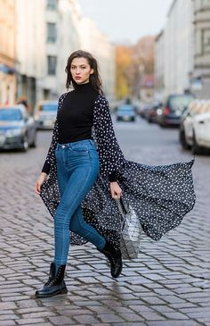 From Germany's Next Topmodel, Fata Hasanovic is pictured here in Berlin looking simply stunning. We love her classic look of black polo neck, high waisted blue jeans and chunky black boots teamed with a modern silver tote and monochrome NA-KD coat. Photo: Christian Vierig