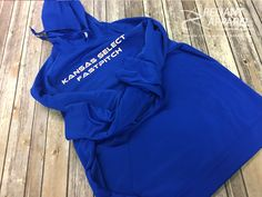 Here's a look at some garments we printed for Kansas Select FastPitch! We can help with all sorts of local sports teams and clubs, so let us know if you're in need of uniforms or merch.