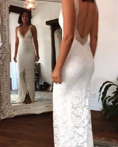 Gorgeous Embroidered Lace Slit Backless Sheath Wedding Dress / Bridal Gown with Deep Neck Cut, Open Back and a Train. Dress by Grace Loves Lace