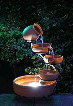 Solar Terracotta Fountain Cascade Water Garden Outdoor Decor LED Feature Light This attractive terracotta cascade water feature, consisting of a jug, three small bowls and a larger bowl that doubles as the water sump, requires no wiring or con. Diy Water Fountain, Garden Water Fountains, Water Garden, Fountain Ideas, Fountain House, Fountain Design, Outdoor Fountains, Garden Ponds, Koi Ponds