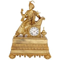 Antique French Orientalist Style Ormolu Mantel Clock   From a unique collection of antique and modern clocks at https://www.1stdibs.com/furniture/decorative-objects/clocks/
