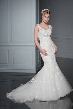 Benjamin Roberts 2409 V-neckline, mermaid gown with lace applique and back button detail.