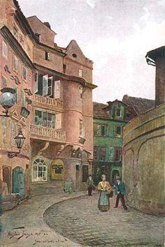 Seminářská ulice při ústí do Karlovy. V pozadí vystupují dnes již neexistující domy čp. 178 a 179 (patrná pouze střecha). Na místě jich a dalších dvou domů vyrostly r. 1905 dva nové činžovní domy v nové uliční čáře, tvoříce tak jakési náměstíčko