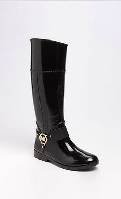 Michel Kors rain boots Perfect for our next trip to London. Love these with the Gold Hardware on them