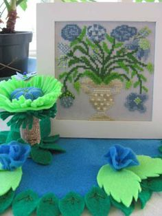 """A Little Blue For You"""" is the title of this cross stitch pattern from By The Bay Needleart that features a large blue floral arrangement."""