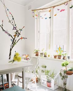 Hola Jungalow friends, it's @little_nicki_ again. This is a favourite sunny spot in my home, captured beautifully by @laurenbamford.  Bring in a bit of nature in with greenery -I'm pretty convinced that window sills were made to be 100% covered in potted plants!  Hang a branch in your window, or plant a little ojos de dios tree like I did.  It all adds a bit of color and handmade fun to your home everyday. *You can check out how to make your own hanging garland and ojos de dios over on The…