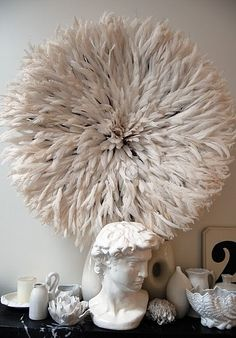 feather juju hat from Cameroon as wall decor