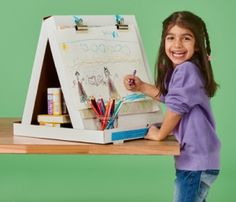 Turn a plain pizza box into a cute and useful art painting drawing easel. Use bulldog clips to hold the artwork.