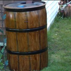 Water Barrel recycled a black plastic barrel I painted to look like wood barrel put under gutter drain pipe of our house to catch rain for watering lawn, flowers ect. We use a pump for hose. you can drill a hole and add a spout for watering cans