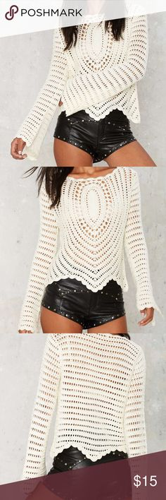 Crochet Sheer Sweater with Flared Sleeves This super cute weater is made in an ivory knit and features a wide neck, bell sleeves, sheer crochet detailing, and asymmetric hem. Unlined. Worn once tags not attached, BRAND NOT MARKED, NASTY GAL FOR EXPOSURE  *Acrylic  *Runs true to size  *Model is wearing size S  *Hand wash cold  *Imported Nasty Gal Sweaters Crew & Scoop Necks