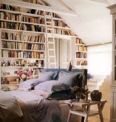 Ideal bedroom...but then who could sleep with all of those books at one's fingertips?