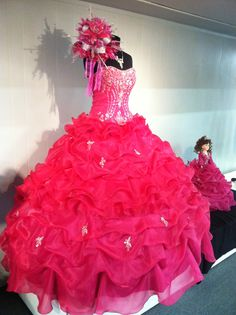 Fuschia Mary's Quinceanera dress with ruffles and a bouquet comes in different colors and accessories!