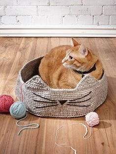 Cute & Cozy Cat Basket Crochet Pattern This is crocheted quickly holding three strands of worsted-weight yarn together. Finish it off by adding ears and whiskers! Size: 15 diameter x 4 excluding ears. Previously published in Crochet World October Crochet World, Crochet Home, Crochet Baby, Crochet Cat Beds, Crochet Stitches, Crochet Patterns, Doilies Crochet, Crochet Basket Pattern, Gato Crochet