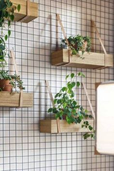 Perhaps the easiest way to give your porch a little bit of greenery is to take to the walls. Hang a metal trellis on the wall and attach a few wooden plant holders with leather straps for an instantly chic vertical garden.