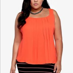Torrid chiffon pleated blouse size 2 Orange color is hard to photograph but stock photo is more accurate. Neon orange color. Pleated style and great for summer. Washed in cold and hung to dry. Smoke and pet free home. torrid Tops Blouses