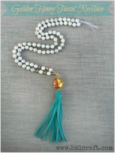 Learn to make a leather tassel as well as how to use silk thread with an attached needle to make this season's hottest accessory: the long tassel necklace.