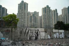 """mianoti:  """" JR, The Wrinkles of the City  JR pastes large-scale photos at locations in Shanghai… (more on MMM)  """""""