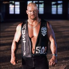 """It's time to celebrate the biggest mudhole stomper in WWE history, """"Stone Cold"""" Steve Austin! Wwe Steve Austin, Austin Wwe, Wwe Lucha, Attitude Era, Austin Stone, Black Leather Vest, Leather Jackets, Wrestling Stars, Wrestling Divas"""