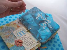 I love the idea of this mini album. Have photos take up an entire page and use the other page next to it for journaling and embellishments.