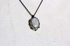 Bloomy Creations  Moonstone Pendant. $32.00, via Etsy.    Lovely way to capture a stone!