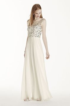 Dazzling in every way, this crystal illusion bodice chiffon casual wedding dress will ensure all eyes are on you on the big day!  Long soft chiffon gives this dress a romantic feel, while the high shi