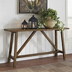 Rustic charm is yours when you add this handsome Altra console table to your home. A classic, understated design makes this piece a cozy addition to a living room, entryway or hallway. The distressed