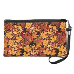Gold and red detailed fall leaves in a seamless repeat pattern.