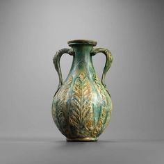 Roman glazed amphora, 1st century A.D. With acanthus leaves and rosettes in relief, 22 cm high. Private collection