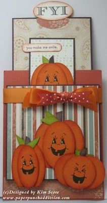 double slider designed by Kim Score -http://www.paperpunchaddiction.com/2010/08/pumpkin-double-slider-card.html