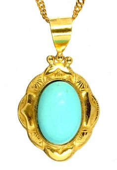 A GOLD PENDANT SET WITH A TURQUOISE EN CABOCHON, MARKED 750 AND A SILVER GILT NECKLET  Sold @ Mellors & Kirk