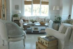 Old suitcases add to the cottagey-vintage-style of this living room...